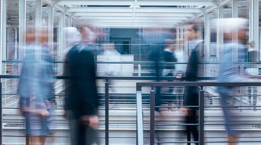 business-people-talking-in-corridor-PSVCLEM(1)